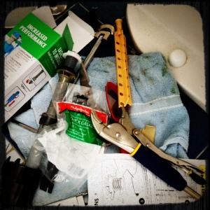 toilet repair detritus