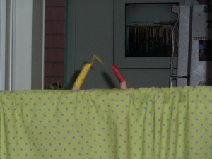 You maybe can't tell, but this is a tension rod holding up our puppet theater.  Tension promotes play.